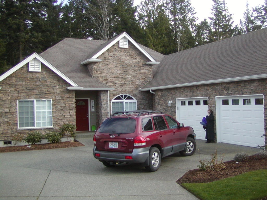 brick home with car - testimonial
