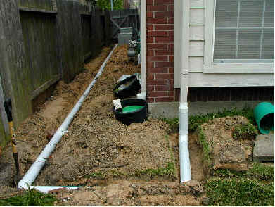 downspout drainage pipes in yard