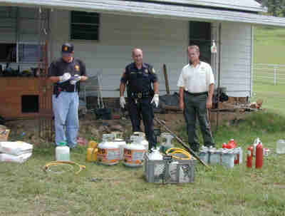 police with meth lab supplies