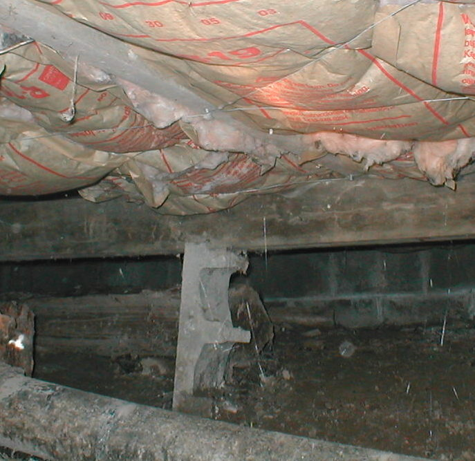 half a cinder block used as support beam under house