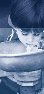 boy drinking water from fountain